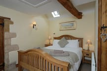 Ground floor:  Bedroom with king-size bed