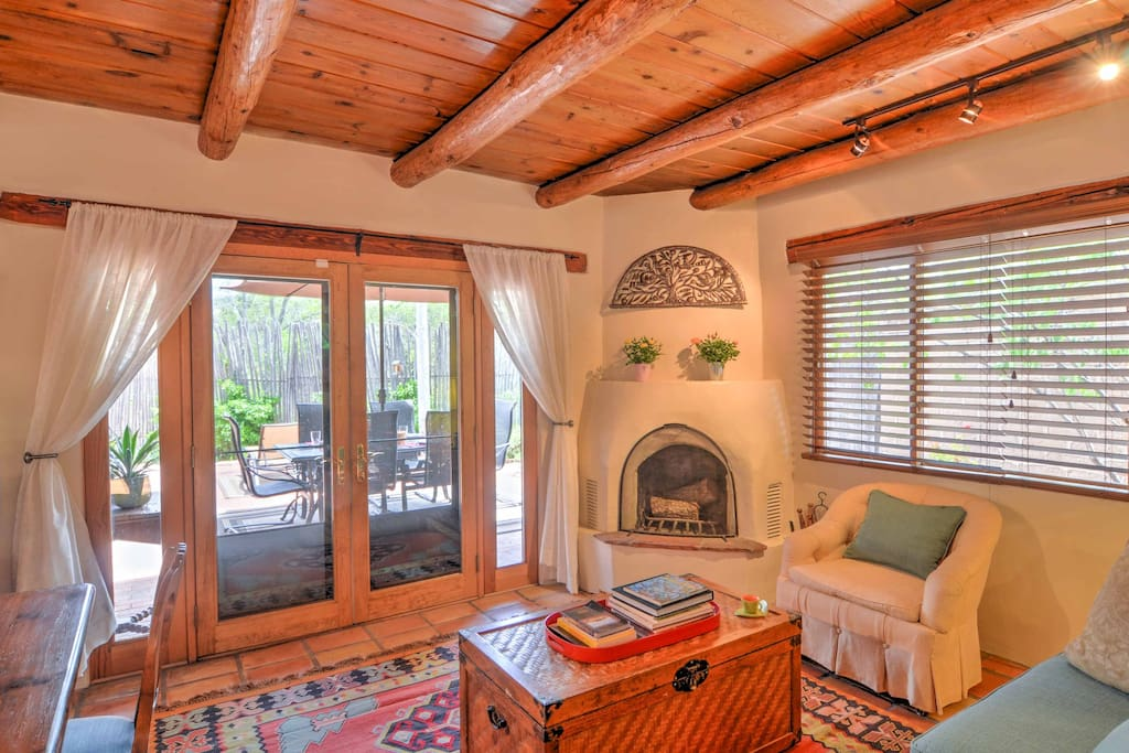 Make use of this wood-burning fireplace in the cold season, or open up the doors and let a cool breeze flow through in the summertime.