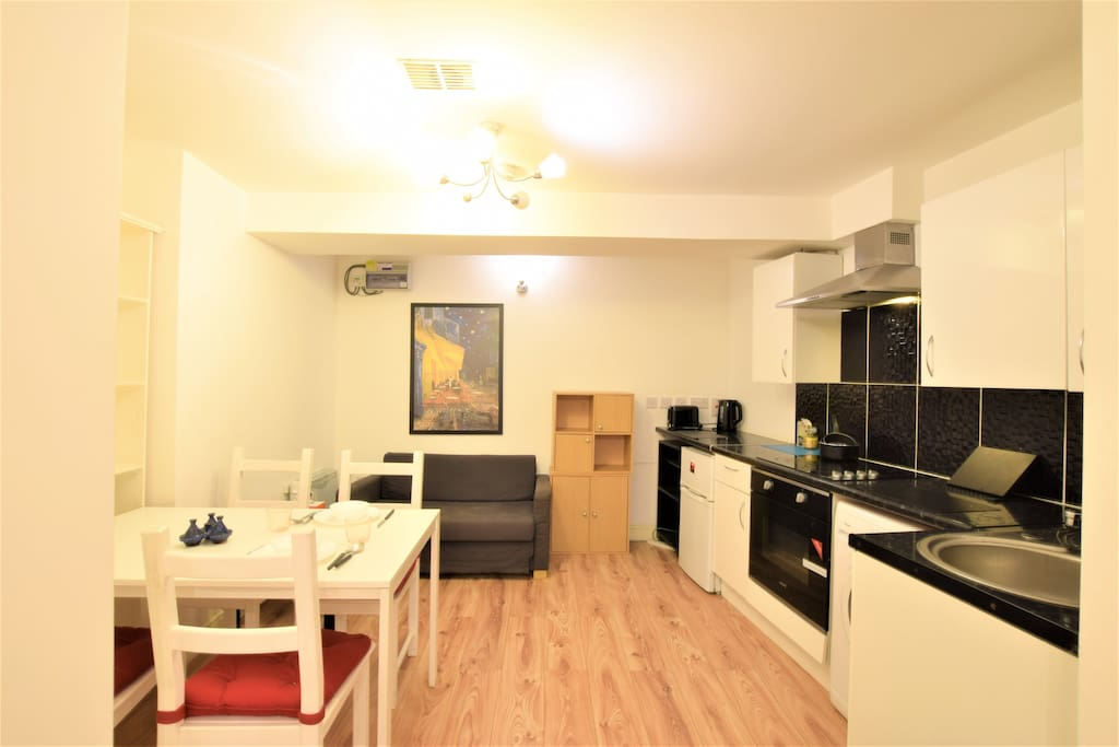 Open plan living area with fully equipped kitchen