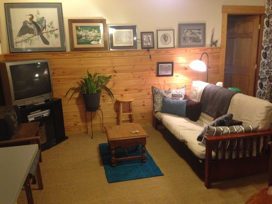 The living area features a full-size futon for extra guests, a t.v. with dvd/vhs player, stereo w/radio/cd/casette, a chest of games!, a small dining table, a counter with free coffee/tea, coffee maker, tea pot, hot plate, mini-fridge and basic kitchen essentials.