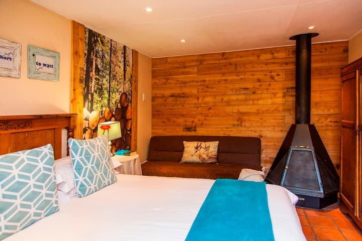 En-suite double room with fireplace in guesthouse
