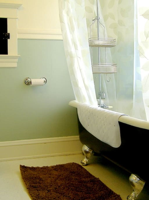 One of the common bathrooms, this one has a clawfoot soaking tub