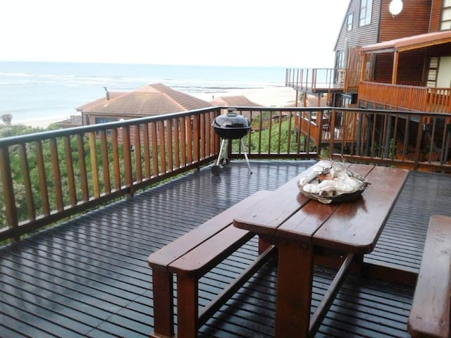 Very large spacious balcony with a stunning view over the Indian Ocean. The best place to watch out for whales and dolphins.  Remember to bring your binoculars. Enjoy a braai in the Weber while watching our amazing sunsets, especially during winter.