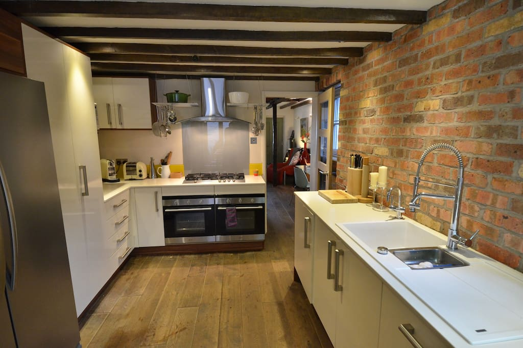 Well equipped kitchen with double oven, Nespresso coffee maker and beautiful tableware
