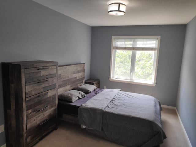 Bedroom with a Queen size bed, Night Stand and lots of storage