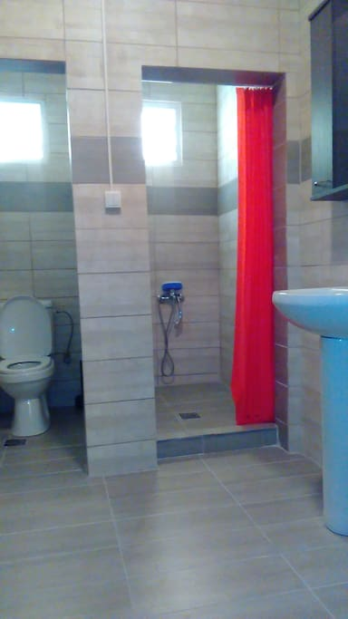 Luminous & spacious 2 seperate built cabins for shower and wc.