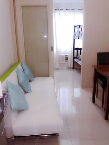 Condo with pool  near Ateneo Miriam UP