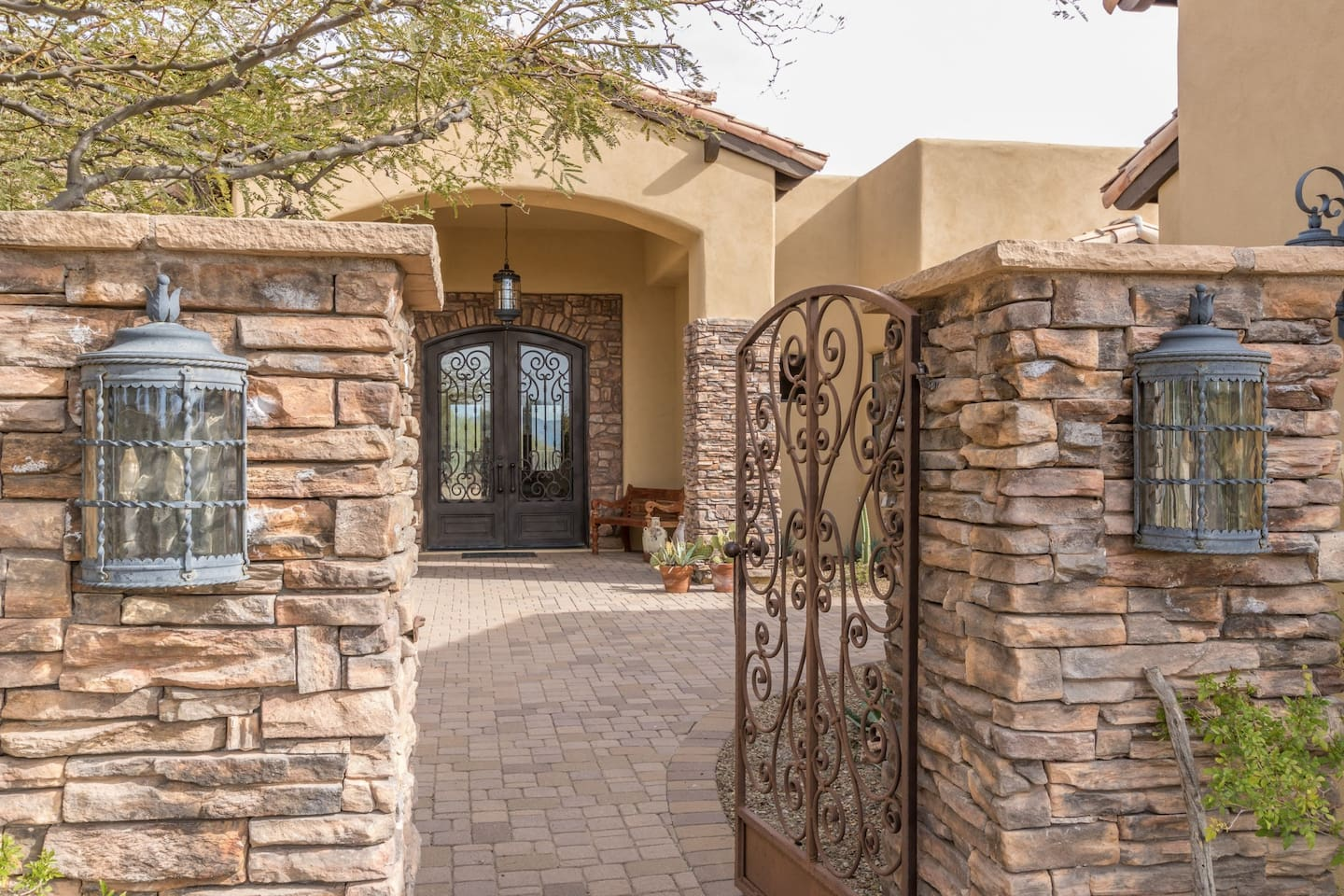 Spectacular front courtyard entry which leads to the Casita's private entry through the courtyard. You will feel transformed into a gorgeous desert quiet oasis as you enter the heavy metal gate. Casita is detached guest house with private entry.