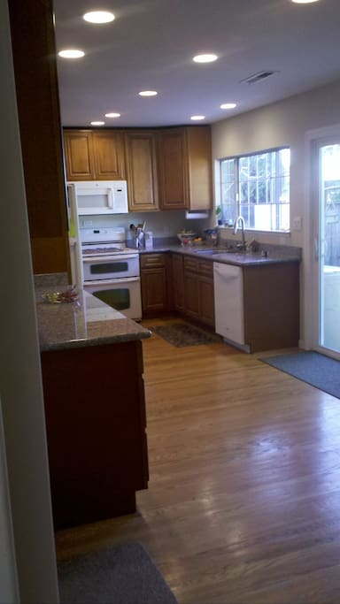 Updated modern kitchen with door to private yard.  Have breakfast on patio.