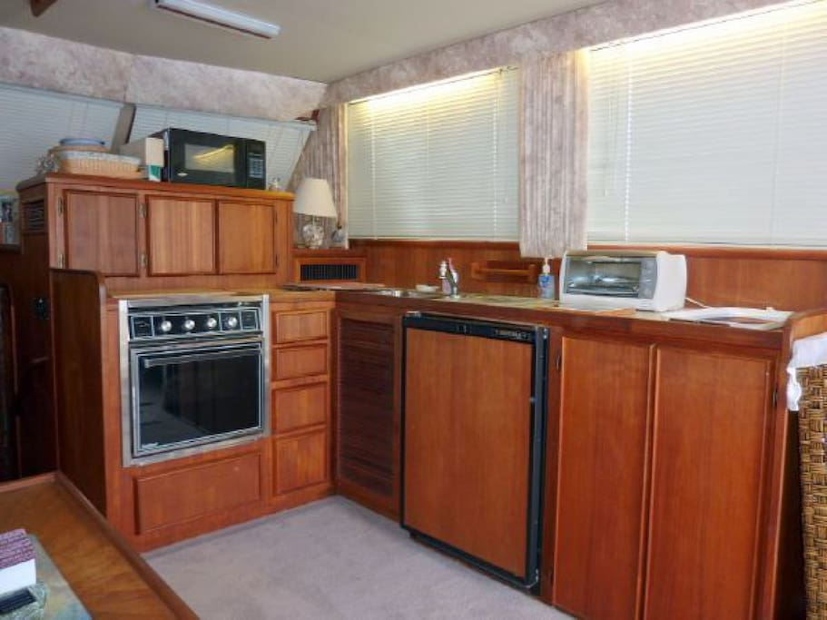 Well-appointed kitchen with stove, oven, sink, coffee-maker, and refrigerator