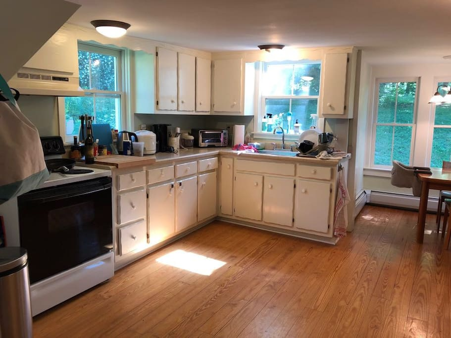 Kitchen contains a breakfast nook with table that seats 4