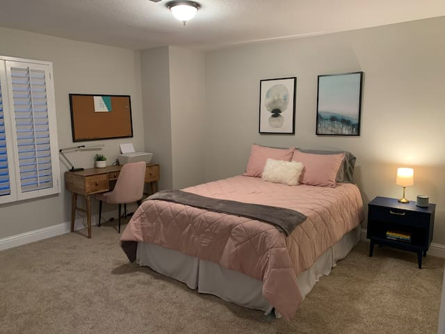Queen bed with desk and large closet