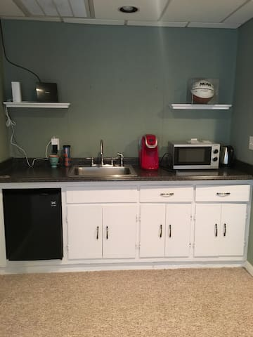 Sink, refrigerator, coffee machine and microwave oven.