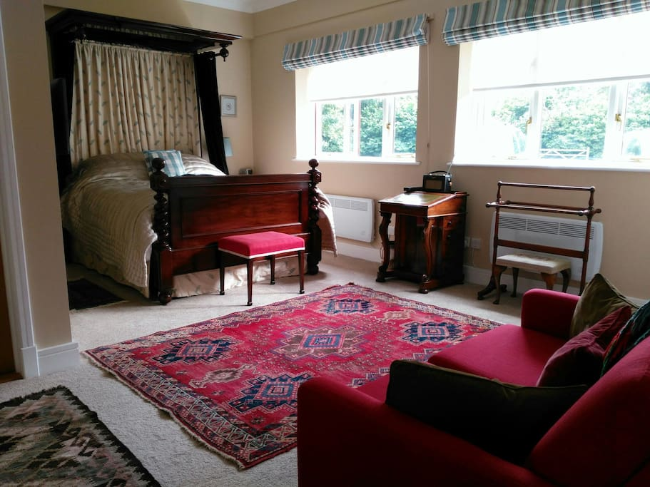A sumptuous king size mahogany bed in the main room with sofa-bed and antique writing desk, towel rails, individual heating elements and new en-suite bathroom. Under the bed is a large all-weather bean bag, should you wish to collapse into it, inside or out in the garden.