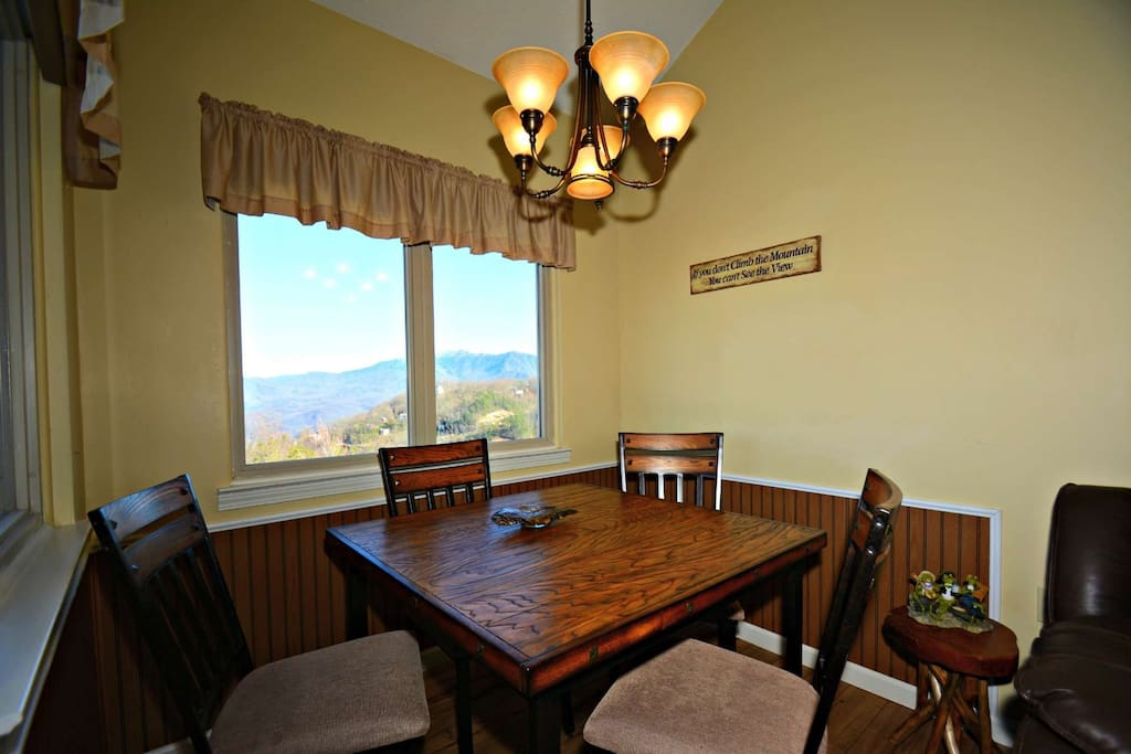 Gather around the dining table (4 chairs) for evening meals, card games, or just to enjoy the view.