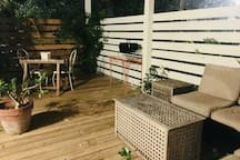 Entry deck has outdoor sectional couch, table and chairs for two and small gas grill. Located on the northern side of the house it never gets too hot during the day and is quiet and private during the evening. Deck doubles your living space.