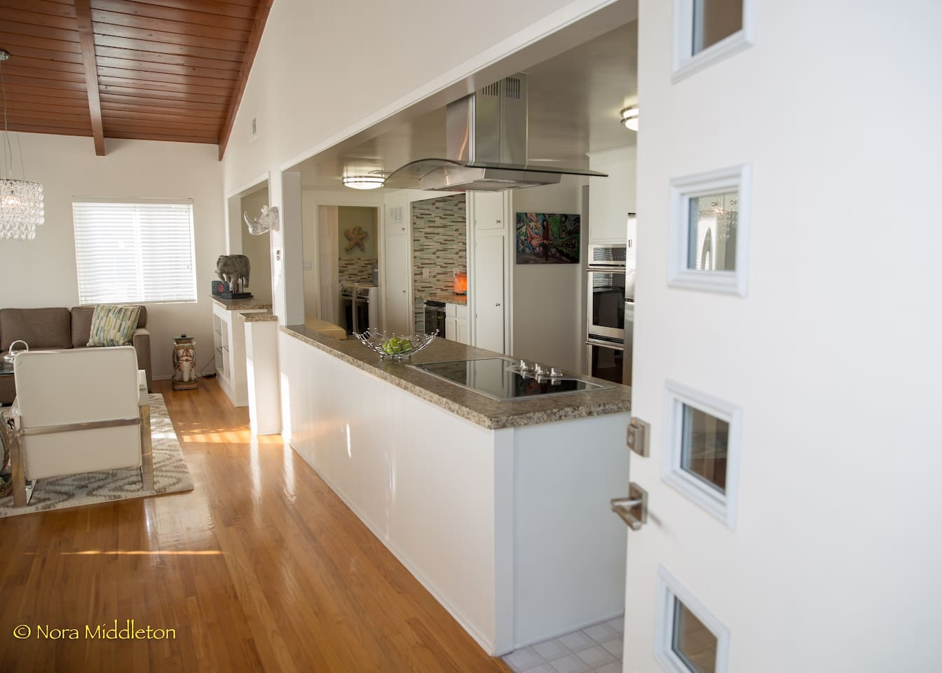 Entering into the spacious living, dining room and kitchen.  Open concept with clean and contemporary lines.  Ocean views from this whole area.