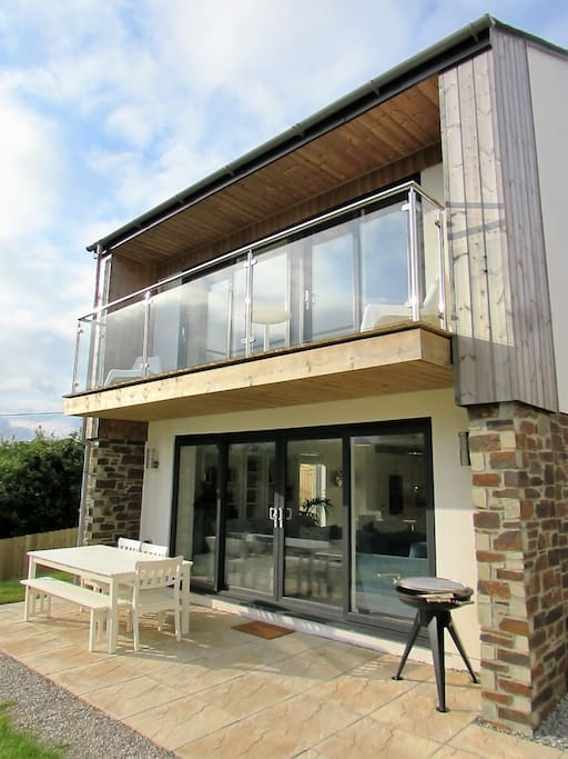 Glass aspect windows and large BBQ and entertainment space