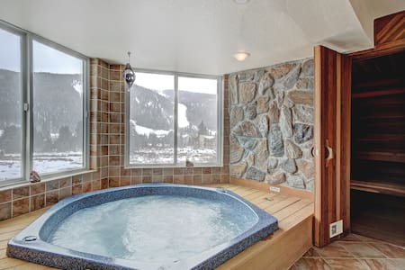 Huge 2 Bedroom Condo with Private Hot Tub - Quick Walk to the Slopes!