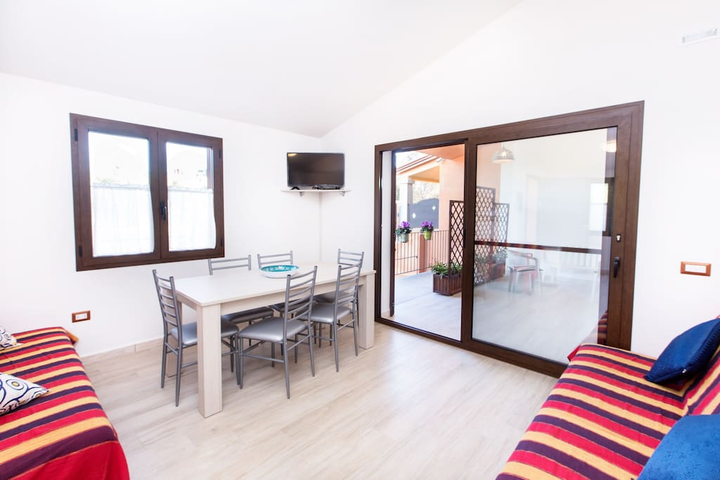 Floor 0 - the living area with terrace & dining table (inside and outside), Tv and 2 double bed sofa