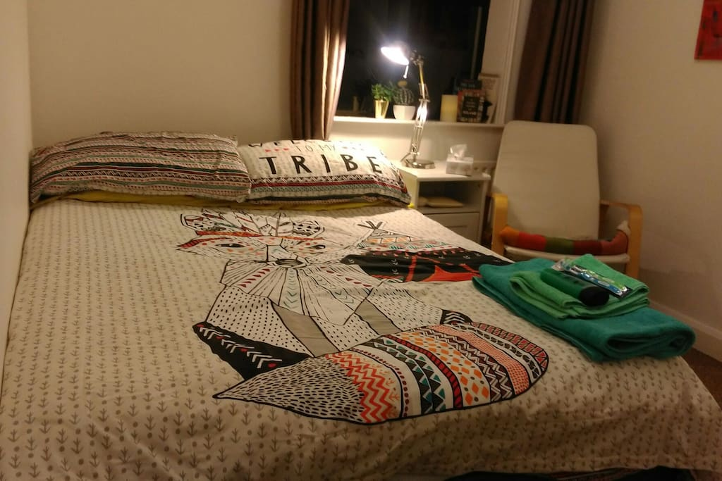 Colourful and cosy room, double bed with plenty of storage space.