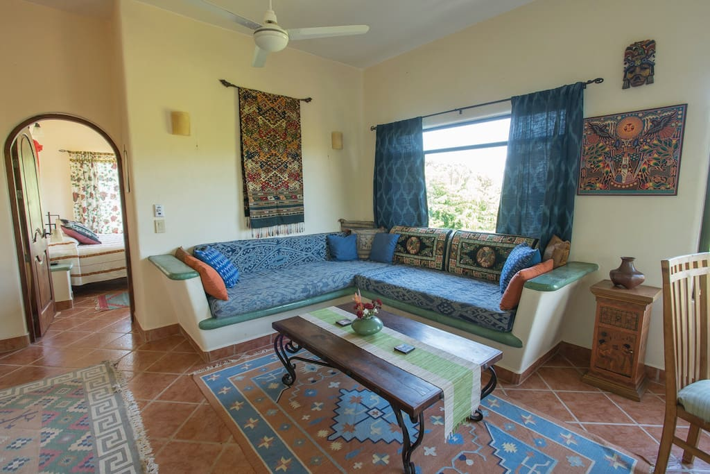 Cozy living room, great for entertaining off the open kitchen and dining area or afternoon siestas..