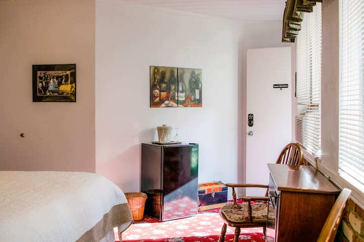 Garden View Room has Private Entry; Refrigerator and Flat Screen Smart TV