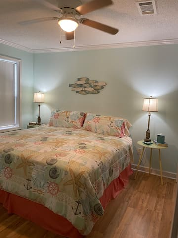 Master bedroom has king bed and a separate entrance into hall bathroom.