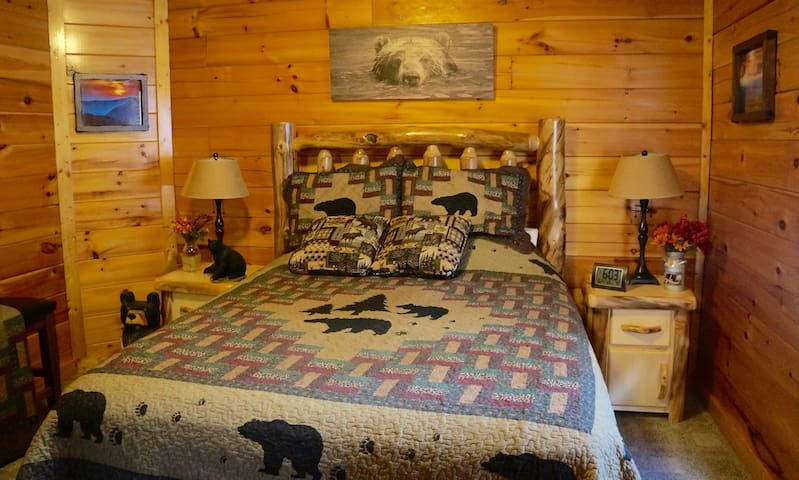 Another pic of the second bedroom on the first floor adorned with this beautiful log style bed
