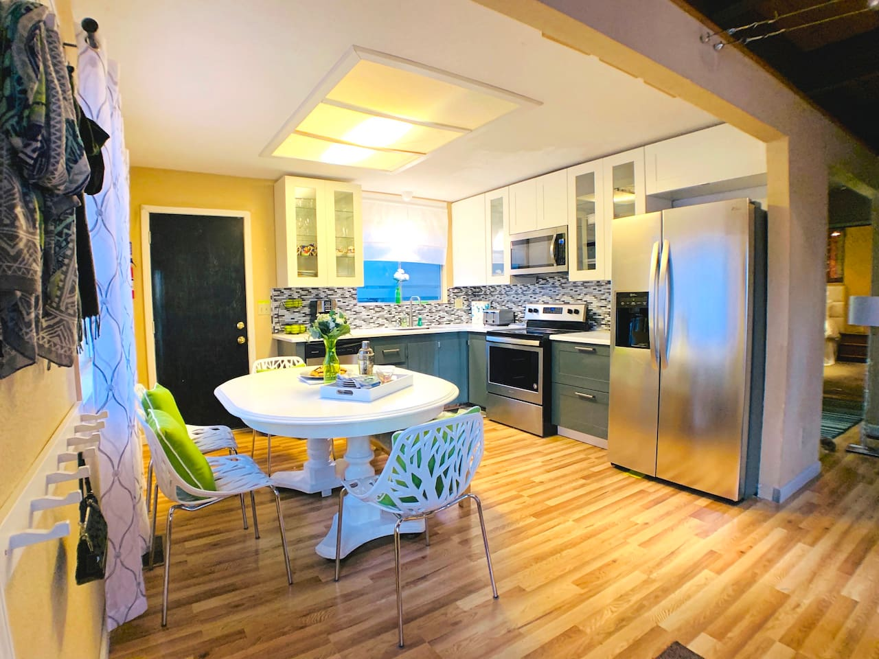 Fully remodeled kitchen is equipped with stainless steel appliances. Refrigerator, stove/oven, coffee maker, microwave, dishwasher, toaster, waffle maker and crock pot, plus all the pots and pans you need to create a delicious family meal at home.