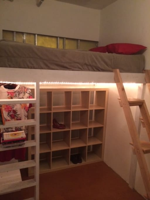 Full-size lofted bed.