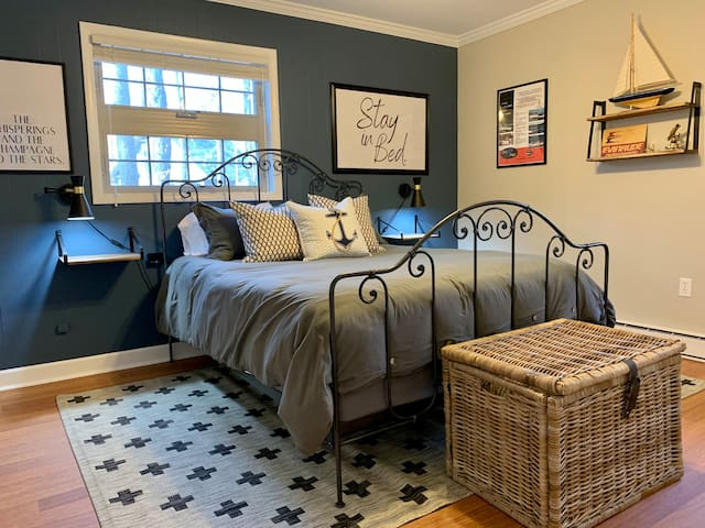 Queen guest room with additional space for a pack 'n play or crate for a pet.