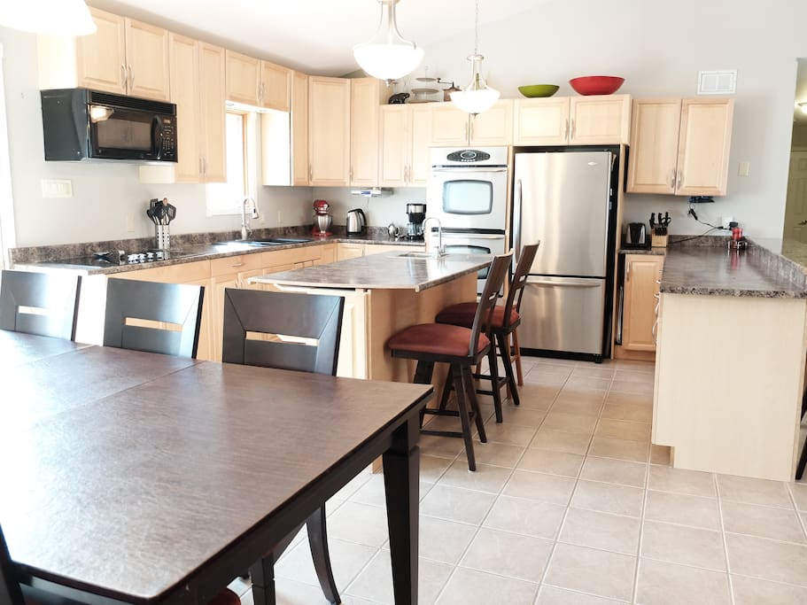 Well equipped kitchen with ample space for guests to cook