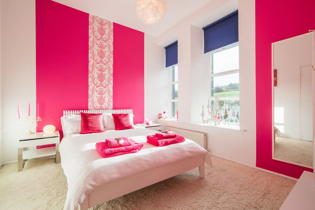 This is our pink room with lovely sunny views into the garden