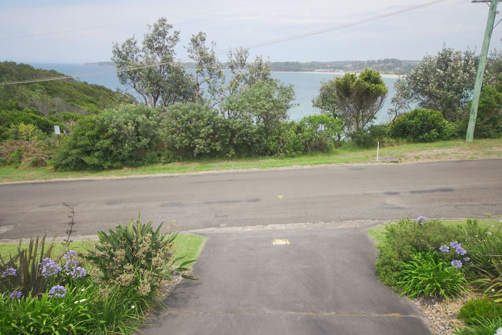 Driveway and front yard ...looking at Mollymook Beach and Ulladulla lighthouse...High on Bannisters Headland - 3 mins walk to Rick Steins at Bannisters