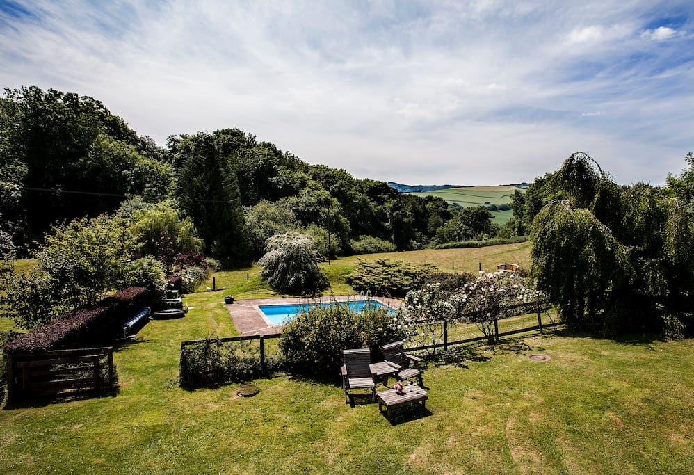 View from the house down towards swimming pool and Brendon hills beyond.