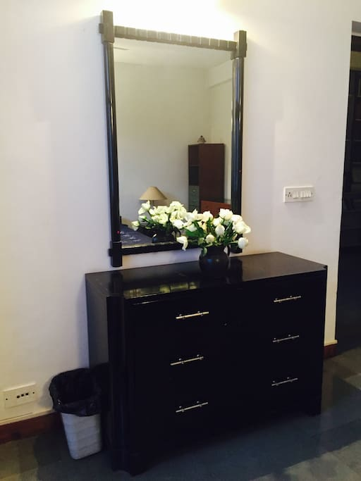 This is the dresser in the room for you to store your things while you are visiting with us. We try to make sure there are fresh flowers or the gardens in the house always have flowers on the bushes.