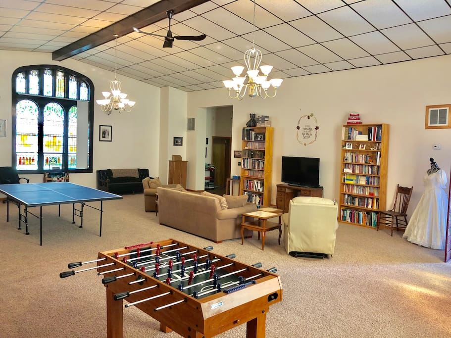 """Shared Living Room and Kitchen with Foosball, Table Tennis, 50"""" TV, and Digital Piano."""