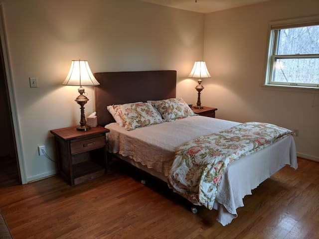 This is bedroom #1, one of two bedrooms on the main floor.  It has a queen-sized bed and a small seating area. All the sheets in the house are cotton percale from either Lands End or The Company Store. Every bed has a down comforter.