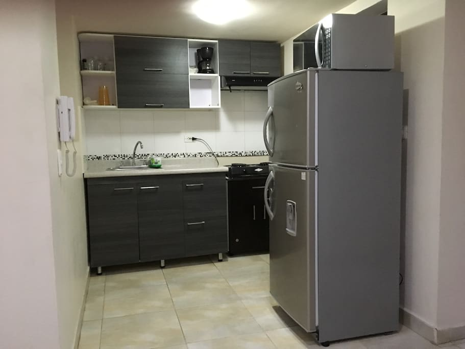 Full kitchen including refrigerator and washer