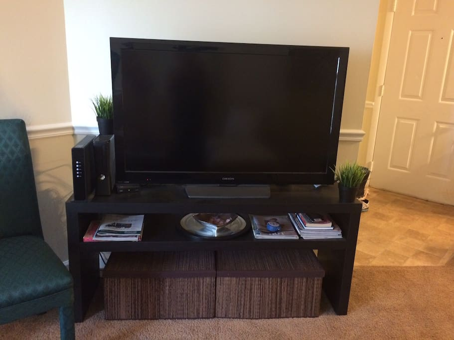 Living room tv with stand- cable and xbox to use during stay