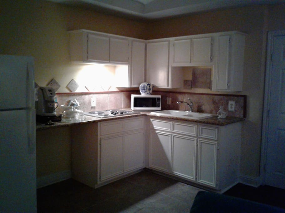 Granite Counter tops and microwave.