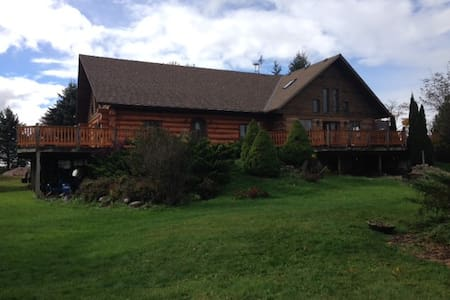 Log House with Large Property