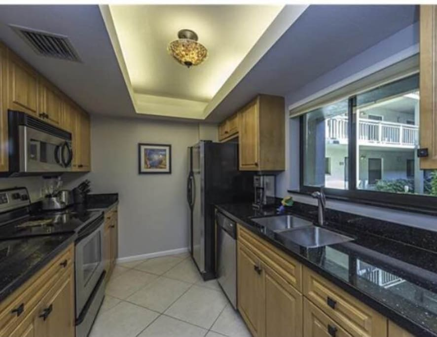 Granite counters, stainless appliances, and stocked with accessories