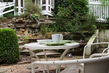 Have breakfast outside at this table for two.
