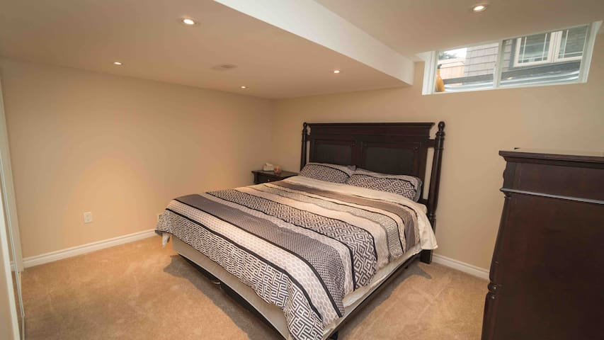 King Bedroom w/ private bathroom and Laundry