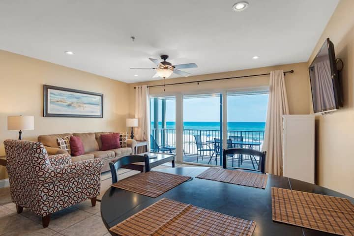 Modern condo with gulf view, full kitchen, and free WiFi. Walk to the beach!