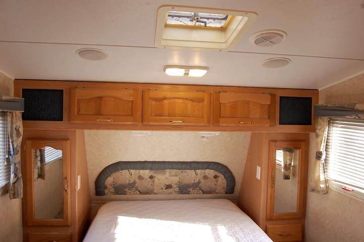 Queen Bed with plenty of closet and drawer space