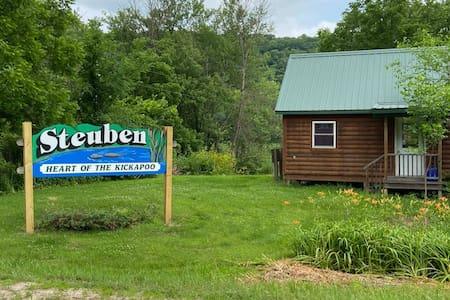 Cabin on the edge of the Kickapoo River in Steuben