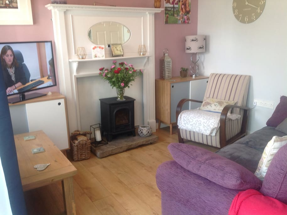 Lounge area with log burner, relax and watch the tv.
